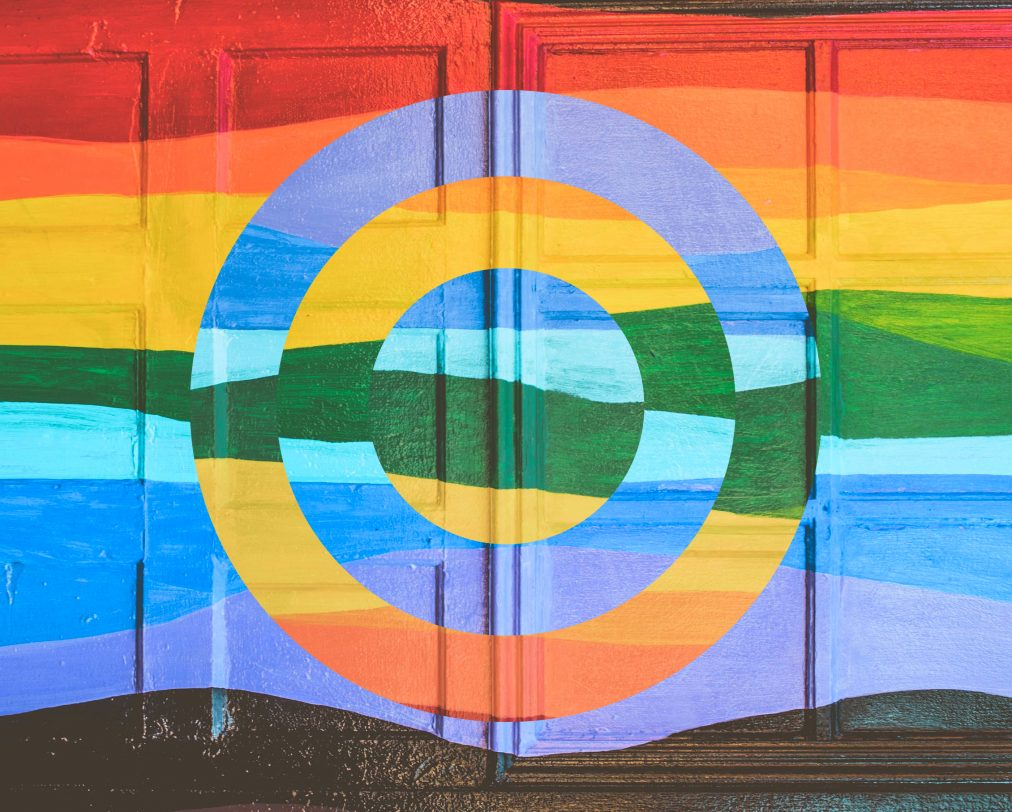 Abstract mural with a rainbow of colors, with two concentric circles flipped 180 degrees, creating a sense of dissonance